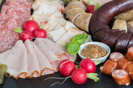 Sausage plate variation on a wooden table. Stock Photo