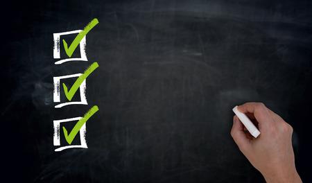 Checklist with Copyspace Hand writing on blackboard.