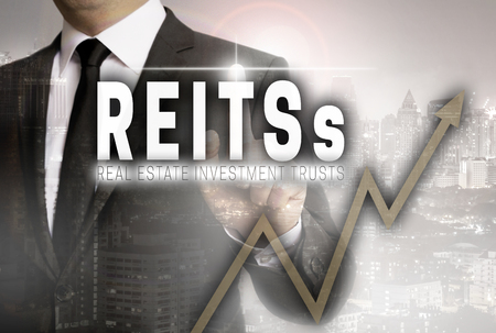 Reits is shown by businessman concept. Standard-Bild