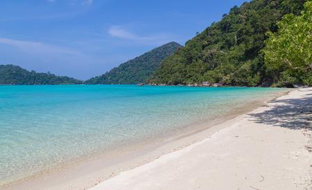 Ko Surin white sand beach and turquoise blue sea Thailand.