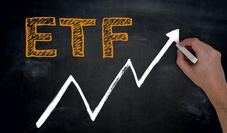 ETF and graph is written by hand on blackboard.