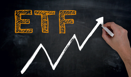 ETF and graph is written by hand on blackboard.