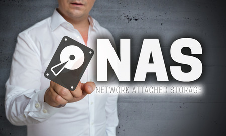 NAS touchscreen is operated by man. Imagens