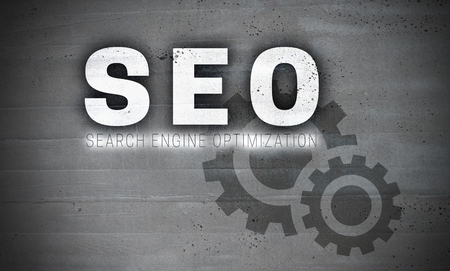 SEO on concrete wall background concept. Stock Photo
