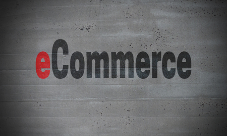eCommerce op concrete muurconcept achtergrond. Stockfoto