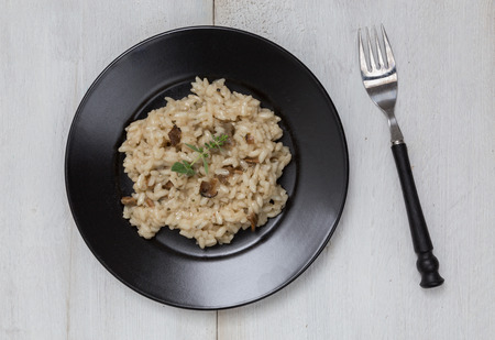 Truffle Risotto with marjoram on a plate.