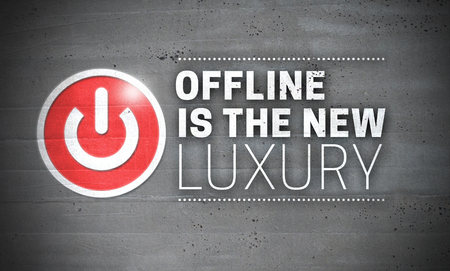 Offline Is The New Luxury on Concrete Wall Concept Background. Stock Photo