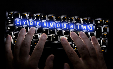 Cybermobbing keyboard is operated by hacker.