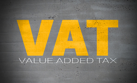 VAT on concrete wall background.