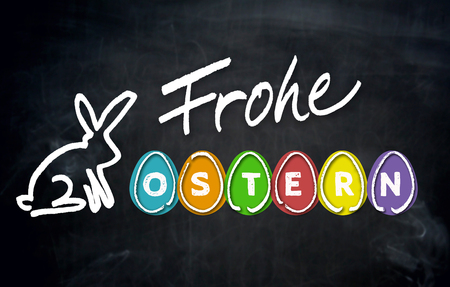 Frohe Ostern (in german happy easter) and easter bunny on blackboard.
