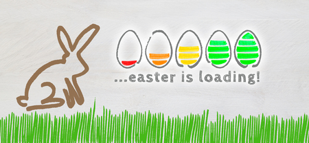 Easter is loading with colorful eggs and Easter Bunny on light wood.