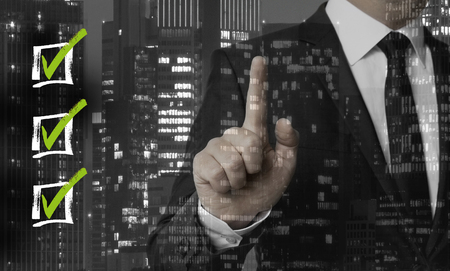 Checklists concept is shown by businessman. Reklamní fotografie