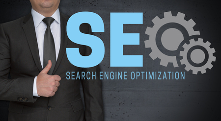SEO concept and businessman with thumbs up.