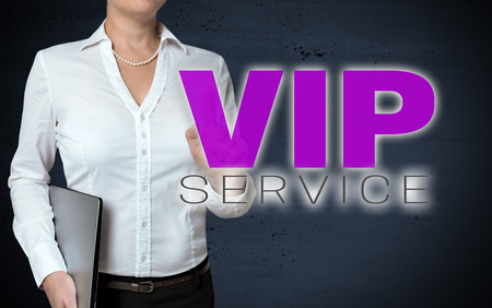 VIP service touchscreen is shown by businesswoman. Stock Photo