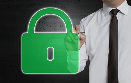 Green U-lock is written by businessman on computer screen. Stock Photo