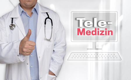 Telemedizin in (german Telemedicine) concept and doctor with thumbs up. 스톡 콘텐츠