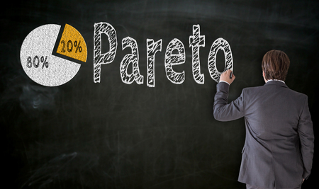 Businessman paints Pareto on blackboard concept.