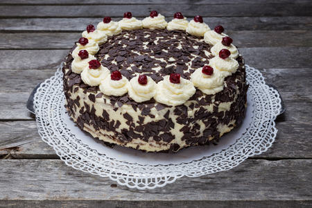Black Forest cake Pie on gray wooden background.