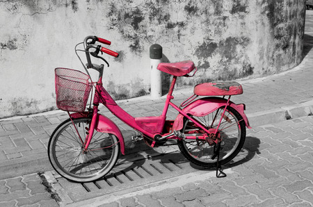Pink bicycle around Meedhoo Raa Atoll Island, Maldives.