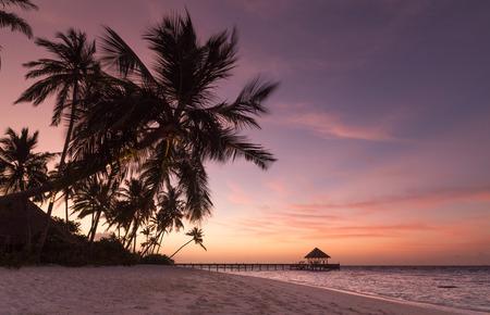 Sunset on the beach Atoll island Maldives. Banco de Imagens