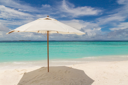 Beach umbrella on the beach Atoll island Maldives. 写真素材