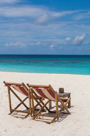 Beach chairs on the beach Atoll island Maldives. Banco de Imagens
