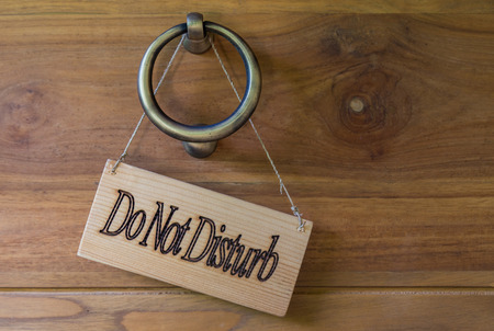 Do not Disturb signboard made of wood detail.