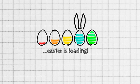 Easter is loading on notepad concept. Imagens