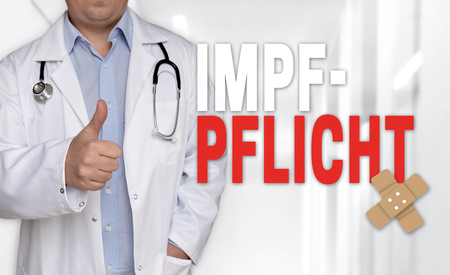 Impfpflicht (in german Vaccination) concept and doctor with thumbs up.
