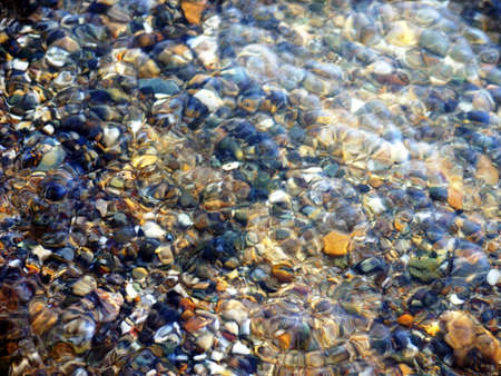 streamlet: Multi-colored pebble at the bottom of a streamlet