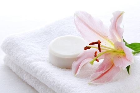 Lily, soap and towel Stock Photo