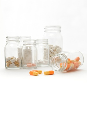 Pills spilling from the bottles photo