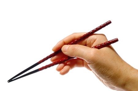 closeup of a hand using chopsticks                             Stock Photo
