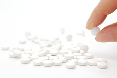 Female hand holding pill Stock Photo