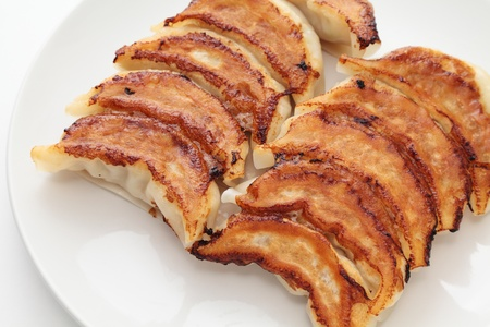 gyoza: Jiaozi, shallow fried dumpling, dumplings stuffed with minced pork and vegetables
