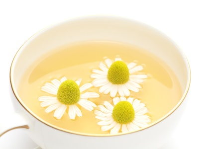 matricaria recutita: Chamomile tea on white background Stock Photo