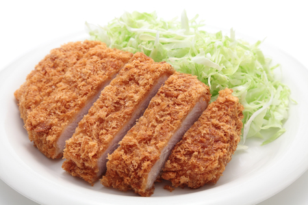 Japanese pork cutlet on white background Фото со стока