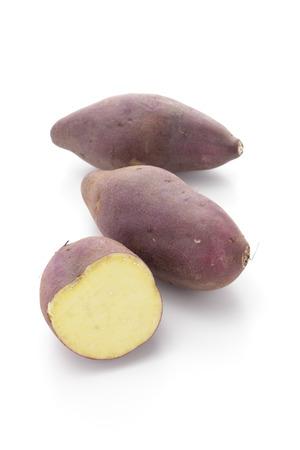 Sweet potatoes on white background Stock Photo