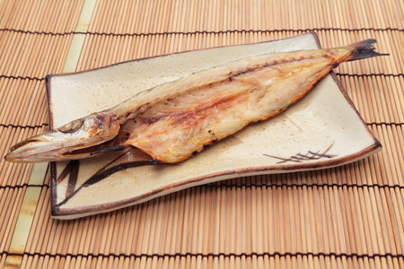 Japanese home cooking, dried barracuda on white background Stok Fotoğraf - 75552037