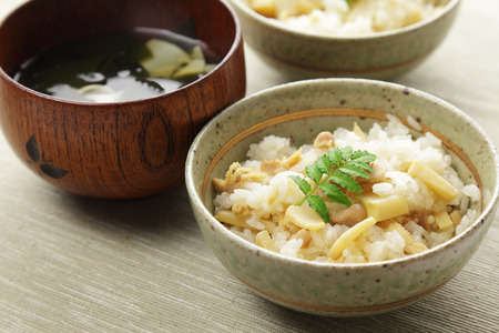Japanese cuisine, Cooked rice with bamboo shoots and the clear soup with bamboo shoots and wakame seaweed Imagens