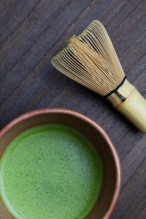 Japanese matcha tea in a bowl and tea whisk