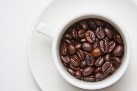 Coffee beans in cups photo