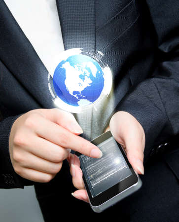 business holding mobile phone with globe Stock Photo - 17722332