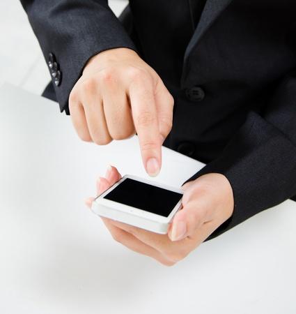 Girl finger touching screen on mobile smart phone