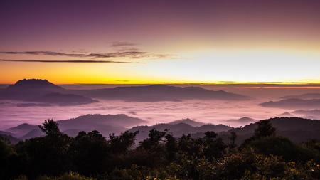 Clear beautiful sunrise over the mountains with the mist of the Huay Nam Dang National Park, Thailand   Stock Photo