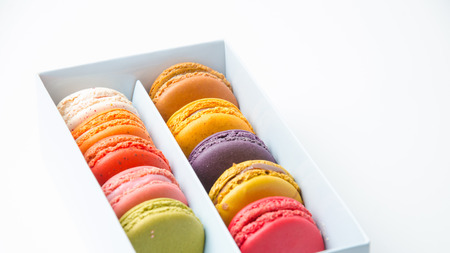 Colorful macaroons in the box on white background