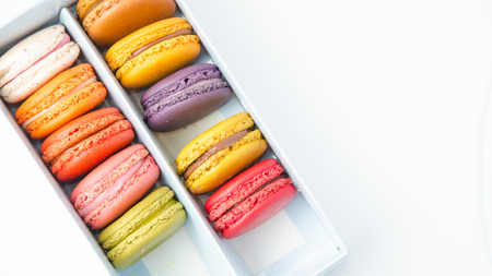 Colorful macaroons in the box on white background photo