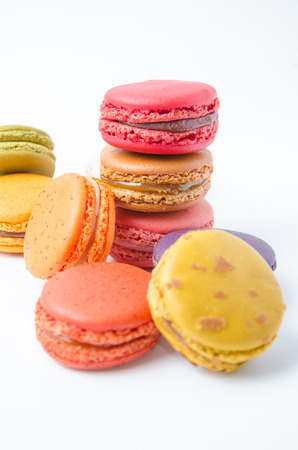 Colorful macaroons on white background photo