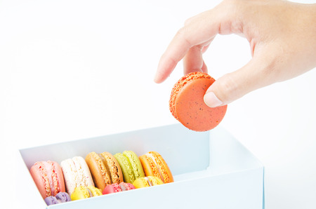 handles macaroon in the box on white background photo