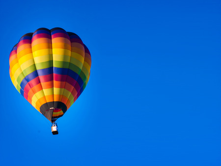 Colorful hot-air balloons flying Stock Photo